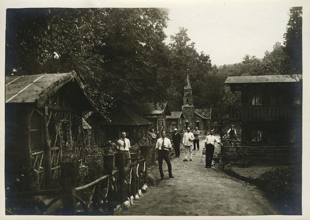 Photograph of German nationals standing outside residential dwellings.