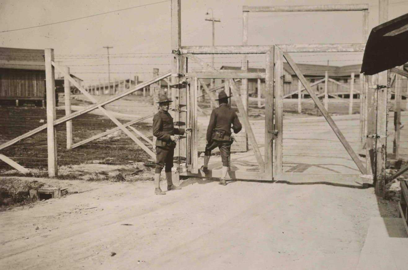 Photograph of guards standing at the main gate to Fort Olgethorpe