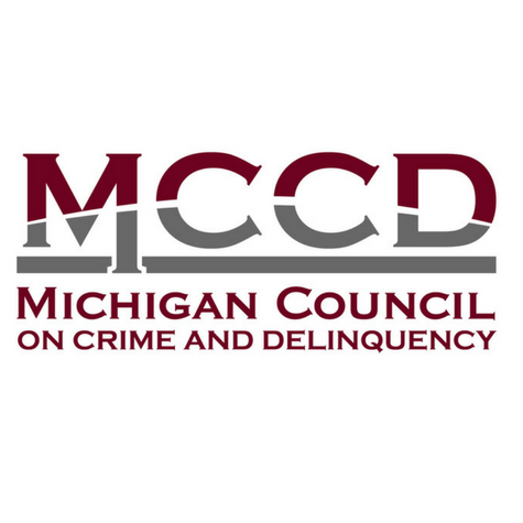 Red and grey logo for the Michigan Council on Crime and Delinquency.